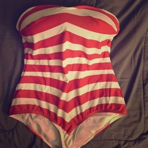Red and white form fitted bathing suit